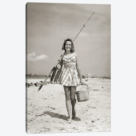 1940s Smiling Young Woman Walking On Beach Looking At Camera Wearing Two Piece Bathing Suit Skirt Carrying Surf Fishing Gear Canvas Print #VTG780} by Vintage Images Canvas Art Print