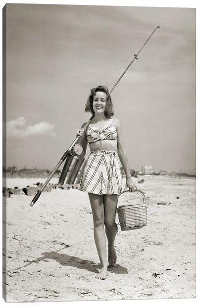 1940s Smiling Young Woman Walking On Beach Looking At Camera Wearing Two Piece Bathing Suit Skirt Carrying Surf Fishing Gear Canvas Art Print