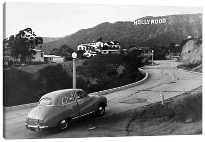 1950s Austin Car Driving Up The Hollywood Hills With Hollywood Sign In Distance Los Angeles Ca USA Canvas Art Print