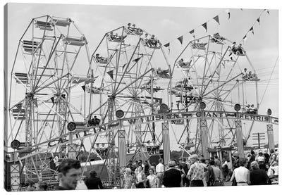 1950s Fair Scene Showing 3 Giant Ferris Wheels & Crowd Below Canvas Art Print