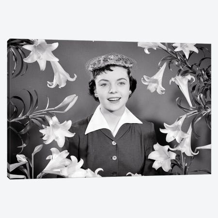 1950s Portrait Smiling Brunette Woman Wearing Easter Bonnet Hat Looking At Camera Surrounded Framed By Easter Lilies Canvas Print #VTG797} by Vintage Images Art Print