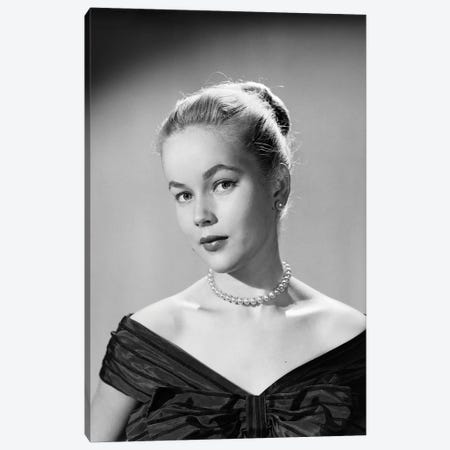 1950s Portrait Young Blond Woman Serious Facial Expression Pearl Necklace Black Satin V Neckline Evening Dress Looking At Camera Canvas Print #VTG798} by Vintage Images Canvas Artwork