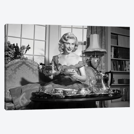 1950s Smiling Blond Woman Elegant Dress & Home Furnishings Pouring Cup Tea From Silver Service Sitting Couch Looking At Camera Canvas Print #VTG802} by Vintage Images Canvas Wall Art
