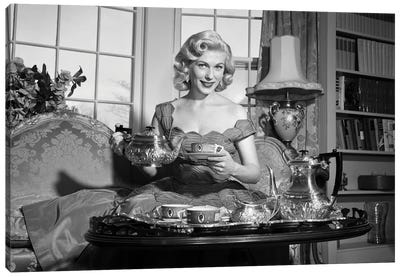 1950s Smiling Blond Woman Elegant Dress & Home Furnishings Pouring Cup Tea From Silver Service Sitting Couch Looking At Camera Canvas Art Print