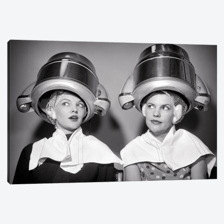 1950s Two Women Sitting Under Beauty Salon Hair Dryers Wearing Hairnets Towels Talking Gossip Canvas Print #VTG808} by Vintage Images Canvas Wall Art
