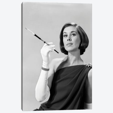 1960s Formally Elegantly Dressed Young Woman Arrogant Expression Holding Long Cigarette Holder Wearing Long White Gloves Canvas Print #VTG817} by Vintage Images Canvas Wall Art