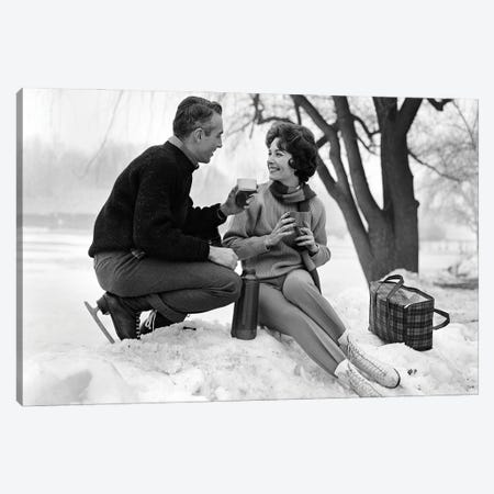1960s Smiling Couple In Snow Wearing Ice Skates Drinking Hot Beverage From Thermos Canvas Print #VTG822} by Vintage Images Canvas Art