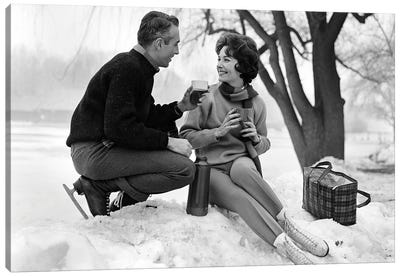 1960s Smiling Couple In Snow Wearing Ice Skates Drinking Hot Beverage From Thermos Canvas Art Print