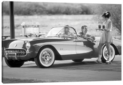 1980s 1990s Carhop On Roller Skates Serving Drinks To Couple In Old Corvette Convertible At 1950s Style Drive-In Restaurant Canvas Art Print