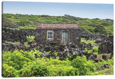 Portugal, Azores, Pico Island, Porto Cachorro. Old fishing community set in volcanic rock buildings Canvas Art Print