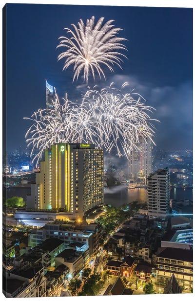 Thailand, Bangkok. Riverside, high angle skyline view with fireworks at dusk. Canvas Art Print
