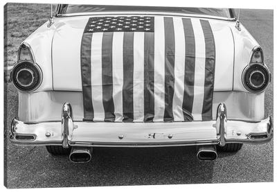 USA, Massachusetts, Essex. Antique cars, detail of 1950's-era Ford draped with US flag. Canvas Art Print