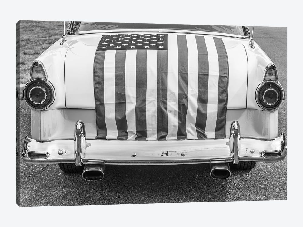 USA, Massachusetts, Essex. Antique cars, detail of 1950's-era Ford draped with US flag. by Walter Bibikow 1-piece Canvas Artwork