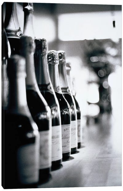 A Row Of Champagne Bottles Canvas Art Print