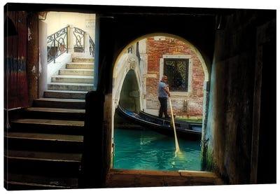 Gondolier Navigates Through A Venice Canal Canvas Art Print